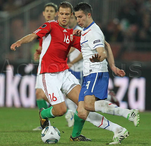 25 03 2011   Krisztian Vadocz Red of Hungary and Robin van Persie Fight for The Ball during The UEFA  Qualifier Game in Budapest between Hungary and The Netherlands men Football National team international match euro Qualif Euro Budapest