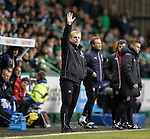 Neil Lennon waving to the Rangers fans during the match