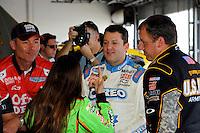 Stewart-Haas teammates Danica Patrick (#10), Tony Stewart (#14) and Ryan Newman (#39) talk in the garage.