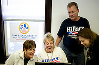 Pro-Hillary Clinton organizers for PUMA PAC, People United Means Action, from left, Ann Walsh (cq), BettyJean Kling (cq), and Pagan Power (cq, THIS IS HIS BLOGGING NAME) laugh over a campaign ad at their Denver, Colorado, USA headquarters, Sunday, August 24, 2008. PUMA is working to support Hillary Clinton against Barack Obama who is scheduled to accept the nomination for president at the Democratic Nation Convention..PHOTOS/ MATT NAGER