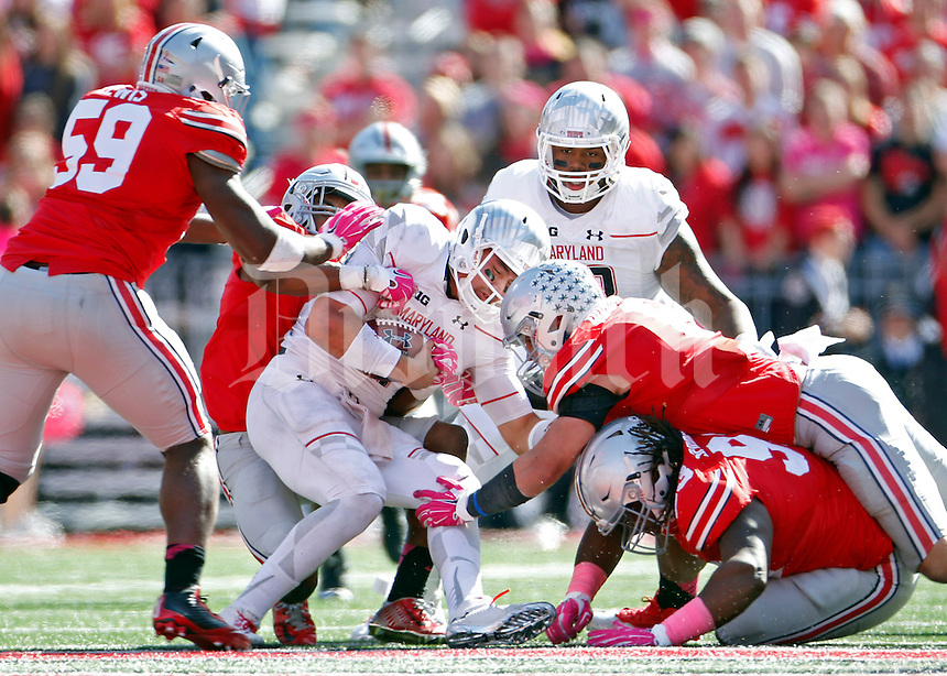 Ohio State Buckeyes linebacker Raekwon McMillan (5) and his teammates take down Maryland Terrapins quarterback Perry Hills (11) in the third quarter of their game in Ohio Stadium on October 10, 2015.  (Dispatch photo by Kyle Robertson)