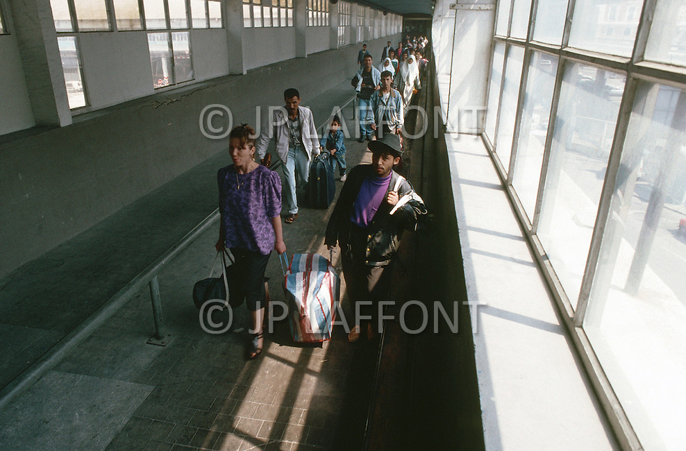 May 27, 1989, Marseilles, France --- Muslim immigration in the port city of Marseille. Passengers arriving from Algeria. --- Image by © JP Laffont