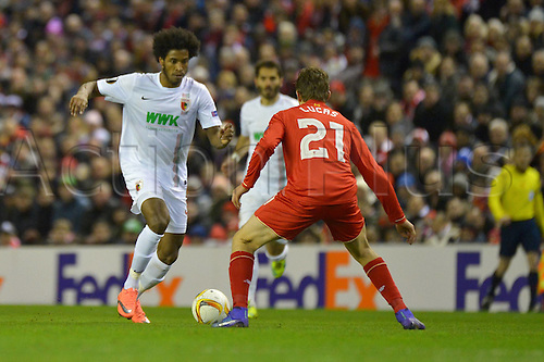 25.02.2016. Liverpool, England. UEFA Europa League game between Liverpool FC and Augsburg.  CAIUBY (FC Augsburg) takes on Lucas Leiva (FC Liverpool) as the game gets deep into the 2nd half