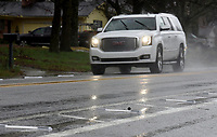 Reflector strips are visible Thursday, March 19, 2020, marking the bike lanes on Rolling Hills Drive in Fayetteville. The city of Fayetteville's Transportation Division, removed bumpers and replaced them with the reflectors. Check out nwaonline.com/200322Daily/ and nwadg.com/photos for a photo gallery.<br /> (NWA Democrat-Gazette/David Gottschalk)