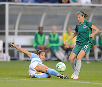 #24 Jill Oakes of the Chicago Reds slide kicks for the ball against #11 Angie Woznuk of the St. Louis Athletica. Athletica beat the Red Stars 2-0...