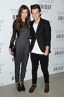 Louis Tomlindson (One Direction) and girlfriend Eleanor Calder arrives at the Unique show as part of London Fashion Week AW13, Tate Modern, London. 17/02/2013 Picture by: Steve Vas / Featureflash