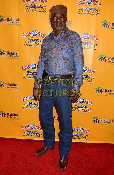Glynn Turman<br /> Red carpet premiere of Ringling Bros. and Barnum &amp; Bailey Present &quot;Built to Amaze&quot; at The Staples Center in Los Angeles, CA, USA, <br /> 11th July 2013.<br /> full length blue print shirt cap hat jeans belt <br /> CAP/ADM/BT<br /> &copy;Birdie Thompson/AdMedia/Capital Pictures