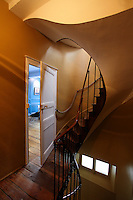 Light rays in the stairwell of the lovely La Maison Pavie appear to lure guests to enter the half-open doorway.