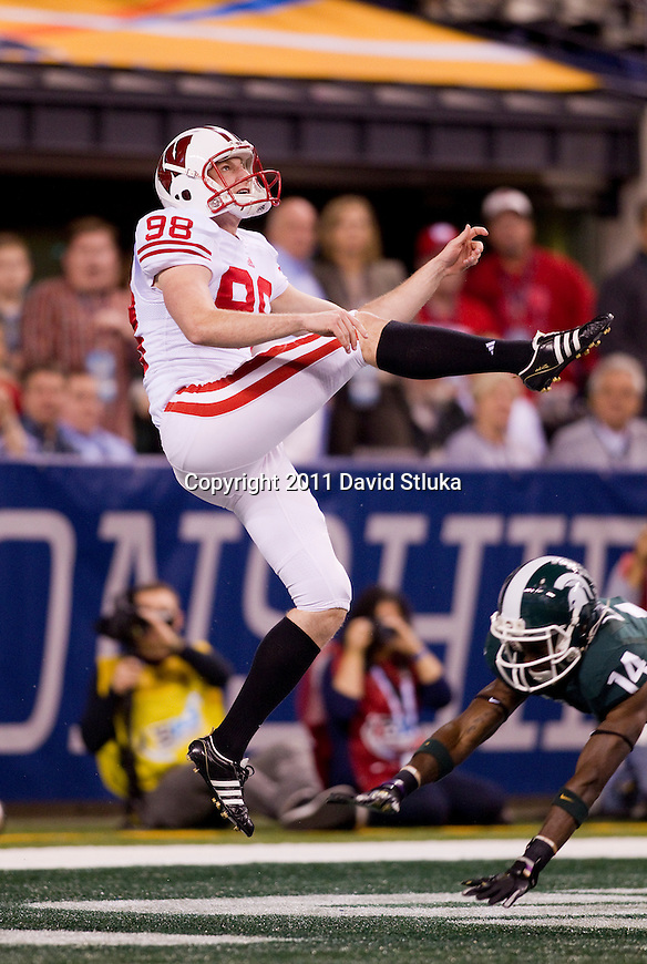 Wisconsin Badgers punter Brad Nortman (98) punts the ball during the Big Ten Conference Championship NCAA college football game against the Michigan State Spartans on December 3 , 2011 in Indianapolis, Indiana. The Badgers won 42-39. (Photo by David Stluka)