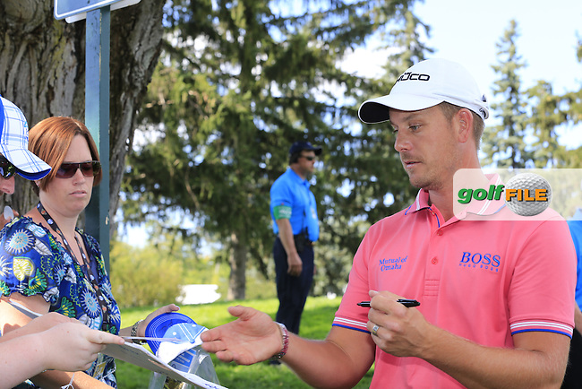 Henrik Stenson (SWE) signs autographs during Tuesday's Practice Day of the 95th US PGA Championship 2013 held at Oak Hills Country Club, Rochester, New York.<br /> 6th August 2013.<br /> Picture: Eoin Clarke www.golffile.ie