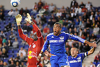 New York Red Bulls goalkeeper Bouna Coundoul (18) takes a ball intended for Teal Bunbury (9) of the Kansas City Wizards. The New York Red Bulls defeated the Kansas City Wizards 1-0 during a Major League Soccer (MLS) match at Red Bull Arena in Harrison, NJ, on October 02, 2010.