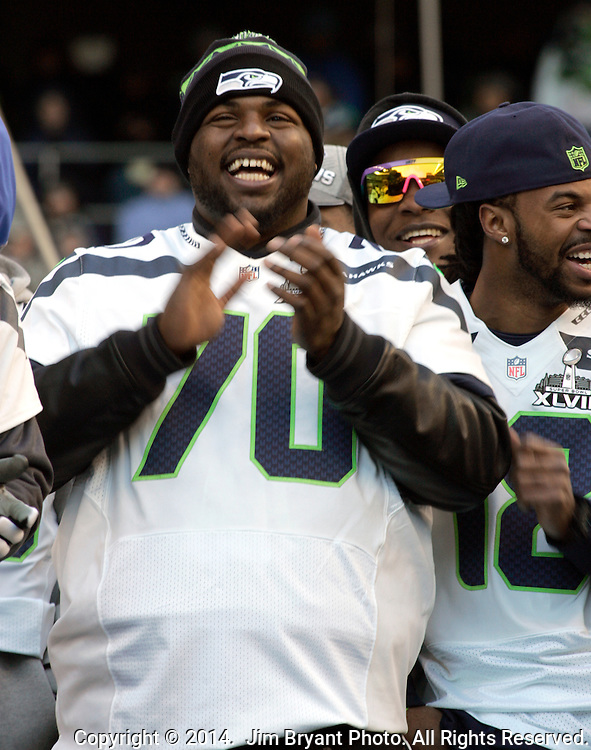 Seattle Seahawks practice squad defensive tackle Michael Brooks (70) smiles while looking out over the fans attending the Super Bowl Championship celebrations at CenturyLink Field on February 5, 2014 in Seattle, Washington. ©2014. Jim Bryant Photo. ALL RIGHTS RESERVED.