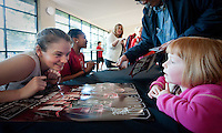 STANFORD, CA-JANUARY 28, 2011: Bonnie Samuelson talks to a young fan during an autograph session after a 74-71 overtime win over the Cal Bears.
