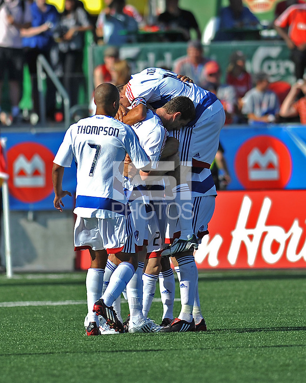 Players from FC Dallas mob Kenny Cooper (33) after scoring the second goal for Dallas at BMO Field on August 3, 2008. FC Dallas won 2-0.