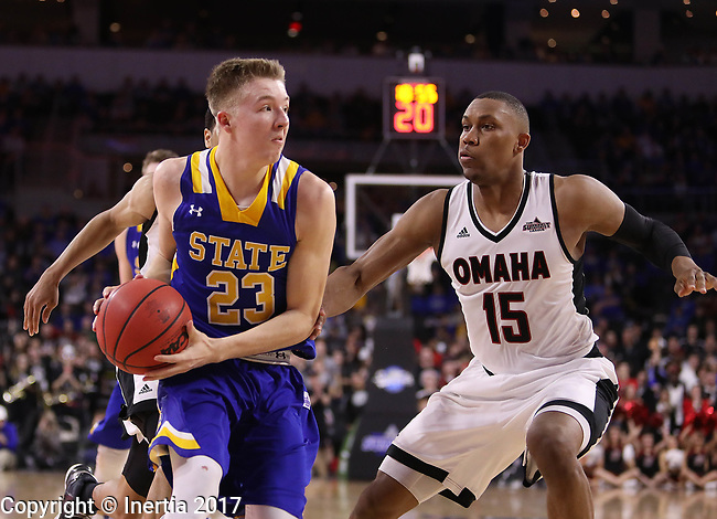SIOUX FALLS, SD: MARCH 7: Reed Tellinghuisen #23 of South Dakota State drives toward Tre'Shawn Thurman #15 of Omaha during the Men's Summit League Basketball Championship Game on March 7, 2017 at the Denny Sanford Premier Center in Sioux Falls, SD. (Photo by Dick Carlson/Inertia)