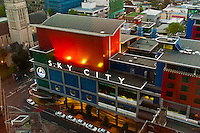 A line of taxis queues underneath the Sky City sign, Central Business District, Auckland, New Zealand
