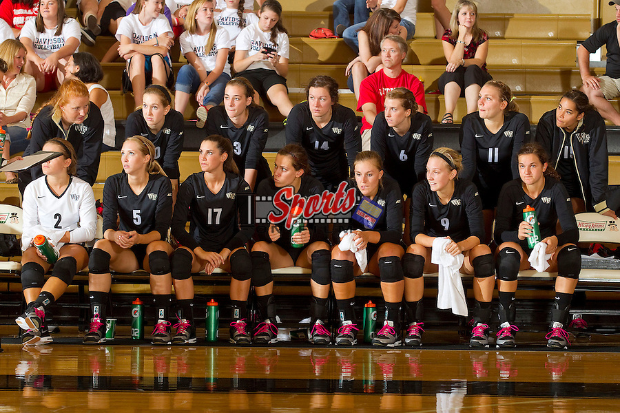 The Wake Forest Demon Deacons during a time out in the match against the Davidson Wildcats in Reynolds Gymnasium on September 1, 2012 in Wake Forest, North Carolina.  The Demon Deacons defeated the Wildcats 3-2.   (Brian Westerholt / Sports On Film)