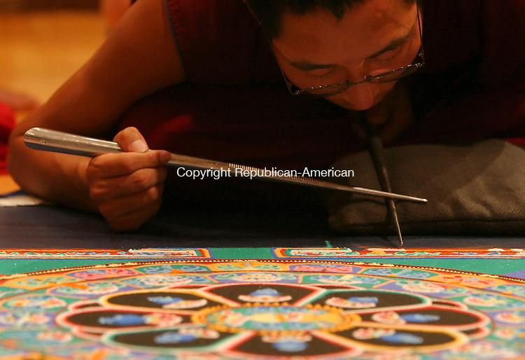 WATERTOWN,  CT 20 September 2005 -092005BZ06-  Dhondup, a Tibetan Buddhist Monk from the Drepung Gomag Monastic University in southern India, uses a &quot;Shakpur&quot; while constructing a sand mandala inside the Mark Potter Gallery at the Taft School in Watertown Tuesday.  The shakpur, a hollow metal tube filled with colored sand, is rubbed to release small amounts with precision allowing the monks to create intricate designs. <br /> Jamison C. Bazinet / Republican-American