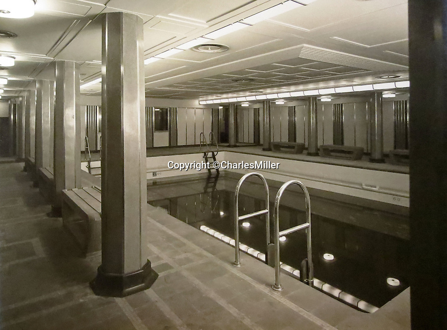 BNPS.co.uk (01202 558833)<br /> Pic: CharlesMiller/BNPS<br /> <br /> 2nd class swimming pool.<br /> <br /> Photo album documents the birth of the RMS Queen Mary - Britain's glamorous transatlantic flagship from the Golden Age of steam.<br /> <br /> The unique album of photographs were presented to Sir John Stewart, Provost of Glasgow in 1937, and detail the historic construction, launch and fitting out of the famous ship.<br /> <br /> Built by John Brown's on the Clyde the historic ship sailed on her maiden transatlantic voyage on 27 May 1936 and captured the Blue Riband in August of that year.<br /> <br /> The ship became a byword for luxury and glamour on the prestigious route from Southampton to New York, remaining in service until 1967, when she was retired to become a floating hotel in Long Beach, California.