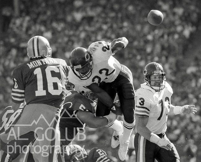 San Francisco 49ers vs. Chicago Bears at Candlestick Park Sunday, November 13, 1985..Bears beat the 49ers 26-10.Chicago Bears Defensive Back Dave Duerson (22) attempts to stop San Francisco Quarterback Joe Montana (16) from passing. Chicago Bears Defensive End Mike Hartenstine (73) in background. .