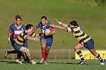Vince Fatu breaks through between Carl Stephens & Male Sau'. McNamara Cup final - Premier 1 Championship, Patumahoe v Ardmore Marist. Patumahoe won 13 - 6. Counties Manukau club rugby finals played at Growers Stadium, Pukekohe, 24th of June 2006.