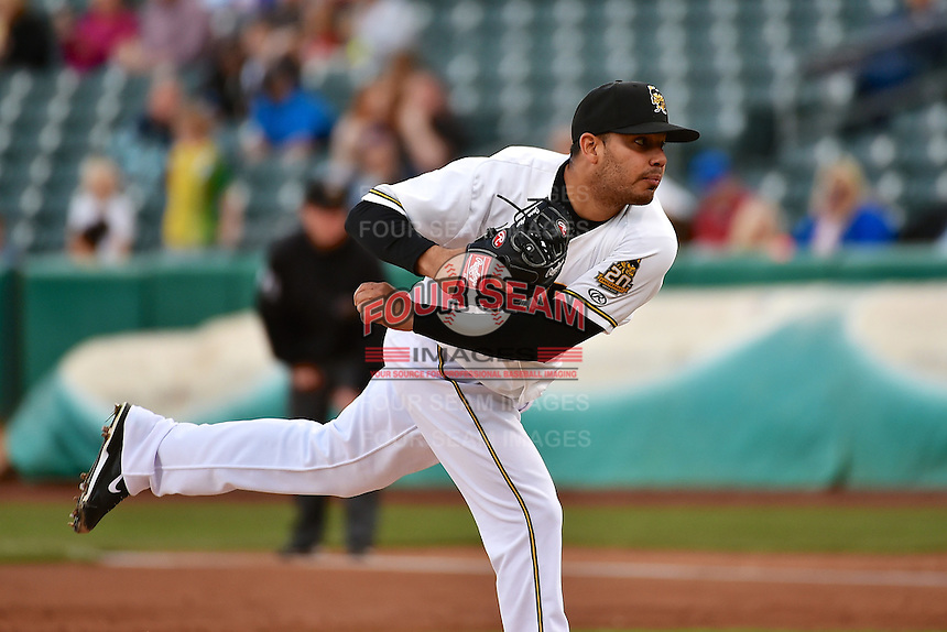 Jose Alvarez (19) of the Salt Lake Bees delivers a pitch to the plate against the Fresno Grizzlies at Smith's Ballpark on April 9, 2014 in Salt Lake City, Utah.  (Stephen Smith/Four Seam Images)
