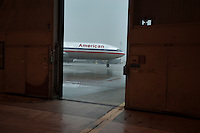 An American Airlines plane sits outside a hangar at Dallas-Fort Worth International Airport (DFW) in Dallas, Texas, Friday, May 14, 2010. ..PHOTO: MATT NAGER