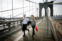 Tenth anniversary of 9/11.  Rebuilding at the World Trade Center site.  Commuters walk over Brooklyn Bridge into Manhattan.  Photo by Ari Mintz.  8/8/2011.