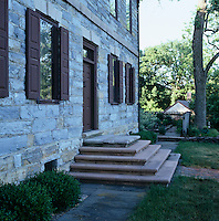 A series of stone steps leads up to the front door of this stone-built converted forge