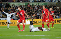 Pictured: A frustrated Eder of Swansea (C) protests to referee after brought down by Dave Winfield (L) of York City Tuesday 25 August 2015<br /> Re: Capital One Cup, Round Two, Swansea City v York City at the Liberty Stadium, Swansea, UK.