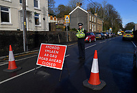 Pictured: Police at the scene of the crash in Trebanos, south Wales, UK.<br /> Re: Jason Thomas and girlfriend Naomi Carter have died and a baby has been taken to hospital after the car they were travelling in crashed into a lamp-post in the Swansea Valley, Wales, UK.<br /> South Wales Police was called to Swansea Road, Trebanos, in the county of Neath Port Talbot at about 3:15am of Saturday.<br /> The 23-year-old male driver and a female passenger, 18, were killed. 11-month-old baby Brogan was taken to hospital with non life-threatening injuries.<br /> Police have appealed for witnesses.