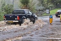 A car drives through a flooded road caused by heavy rain in Crickhowell, south Wales, UK. Saturday 26 October 2019
