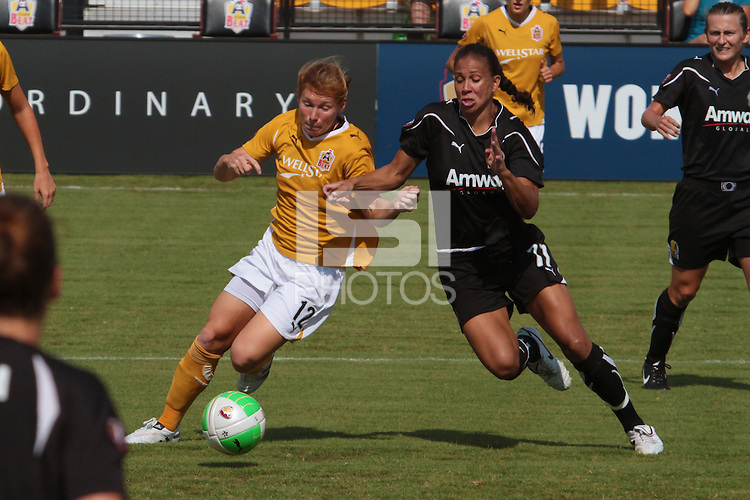 Lori Chalupny (12) of the Atlanta Beat and Shannon Boxx (77) of FC Gold Pride fight for the ball. The Atlanta Beat and FC Gold Pride played to a 0 - 0 draw during a Women's Professional Soccer (WPS) match at KSU Atlanta Beat Stadium Kennesaw, GA, on August 1, 2010.