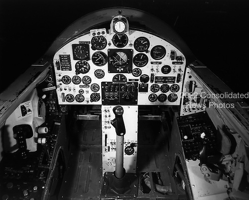 April, 1963 photo of the X-15 cockpit.  This joint program by the National Aeronautics and Space Administration (NASA), the United States Air Force, the United States Navy, and North American Aviation, Inc. operated the most remarkable of all the rocket research aircraft. Composed of an internal structure of titanium and a skin surface of a chrome-nickel alloy known as Inconel X, the X-15 had its first, unpowered glide flight on June 8, 1959, while the first powered flight took place on September 17, 1959. Because of the large fuel consumption of its rocket engine, the X-15 was air launched from a B-52 aircraft at about 45,000 ft and speeds upward of 500 mph. The airplane first set speed records in the Mach 4-6 range with Mach 4.43 on March 7, 1961; Mach 5.27 on June 23, 1961; Mach 6.04 on November 9, 1961; and Mach 6.7 on October 3, 1967. It also set an altitude record of 354,200 feet (67 miles) on August 22, 1963, and provided an enormous wealth of data on hypersonic air flow, aerodynamic heating, control and stability at hypersonic speeds, reaction controls for flight above the atmosphere, piloting techniques for reentry, human factors, and flight instrumentation. The highly successful program contributed to the development of the Mercury, Gemini, and Apollo piloted spaceflight programs as well as the Space Shuttle program. The program's final flight was performed on October 24, 1968.