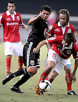 Toluca FC midfielder Diego De La Torres (21) shields the ball against DC United forward Jaime Moreno (99).  Toluca FC defeated DC United 3-1in the Concacaf Champions League tournament,at RFK Stadium Wednesday, August 26  2009.
