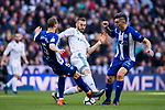 Karim Benzema (C) of Real Madrid fights for the ball with Victor Laguardia Cisneros (L) and Daniel Alejandro Torres Rojas, D Torres, of Deportivo Alaves during the La Liga 2017-18 match between Real Madrid and Deportivo Alaves at Santiago Bernabeu Stadium on February 24 2018 in Madrid, Spain. Photo by Diego Souto / Power Sport Images