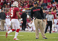 Stanford, CA -- November 23, 2013:  Stanford's David Shaw talks with Kodi Whitfield during a game against Cal at Stanford Stadium. Stanford defeated Cal 63-13.