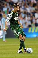 Eric Brunner (5) defender Portland Timbers passes the ball... Sporting Kansas City defeated Portland Timbers 3-1 at LIVESTRONG Sporting Park, Kansas City, Kansas.