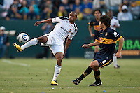 Forward Tristan Bowen (17) passing the ball past defender Ezequiel Munoz (6) during the second half of a friendly between LA Galaxy and Boca Juniors. The game was held at the Home Depot Center in Carson, CA on May 23, 2010. The final score was LA Galaxy 1, Boca Juniors 0.