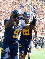 C.J. Anderson of California celebrates with teammates after scoring a touchdown during the game against Southern Utah at Memorial Stadium in Berkeley, California on September 8th, 2012.   California Golden Bears defeated Southern Utah, 50-31.