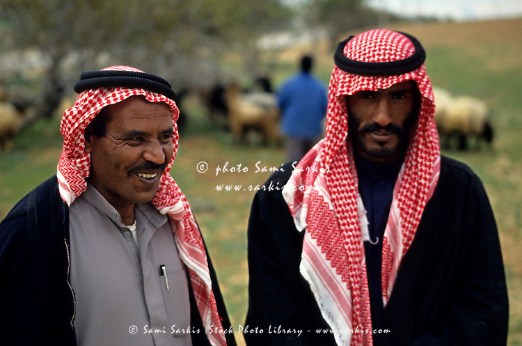 Portrait of two Bedouins wearing keffiehs, the traditional headwear, Jordan.