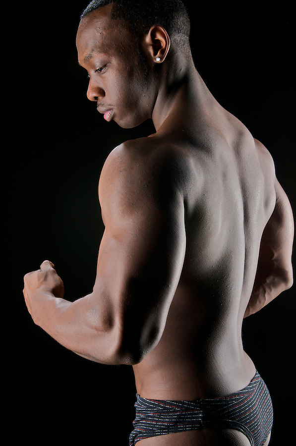 Close up of worked out biceps and back.
