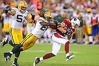 Aug. 28, 2009; Glendale, AZ, USA; Arizona Cardinals wide receiver Jerheme Urban (right) is pursued by Green Bay Packers safety (20) Atari Bigby and linebacker (51) Brady Poppinga during a preseason game at University of Phoenix Stadium. Mandatory Credit: Mark J. Rebilas-