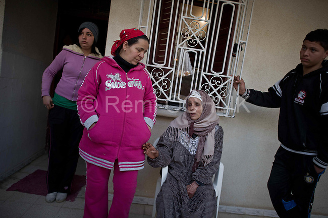 © Remi OCHLIK/IP3 -  Kasserine Tunisia - Saturday 23 January - As her son, Hosni Kaliyia is hosptalized in Tunis, mrs Kaliyla s waiting for news at home..Hosni was an approximatley aged of 30 man, who never figured out to find a job and set himself on fire in Kasserine and was critically burned, the 6 january 2011. His desperate act start up the violence in Kasserine where 56 protestors has been by policemen and sniper.