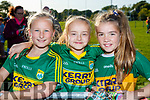 Caoimhe O'Callaghan, Abbie Maguire and Doireann Dywer, all from Kilcummin, enjoying the Kerry Minor home coming at Kilcummin GAA pitch on Monday night last.