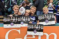 Young Bath Rugby supporters show off their autographed prints at the end of the session. Bath Rugby Captain's Run on October 30, 2015 at the Recreation Ground in Bath, England. Photo by: Patrick Khachfe / Onside Images