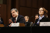 """Director Christopher Wray, Federal Bureau of Investigation (FBI), left, and Director Gina Haspel, Central Intelligence Agency (CIA), right, testify before the United States Senate Select Committee on Intelligence during an open hearing on """"Worldwide Threats"""" on Capitol Hill in Washington, DC on Tuesday, January 29, 2019.<br /> Credit: Martin H. Simon / CNP"""