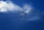 A skier carves a turn in deep powder snow at Mount Baker Ski Resort, Washington.