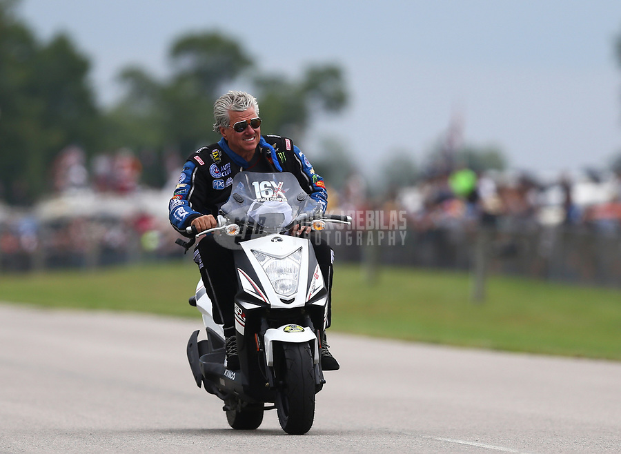 Aug 18, 2017; Brainerd, MN, USA; NHRA funny car driver John Force during qualifying for the Lucas Oil Nationals at Brainerd International Raceway. Mandatory Credit: Mark J. Rebilas-USA TODAY Sports