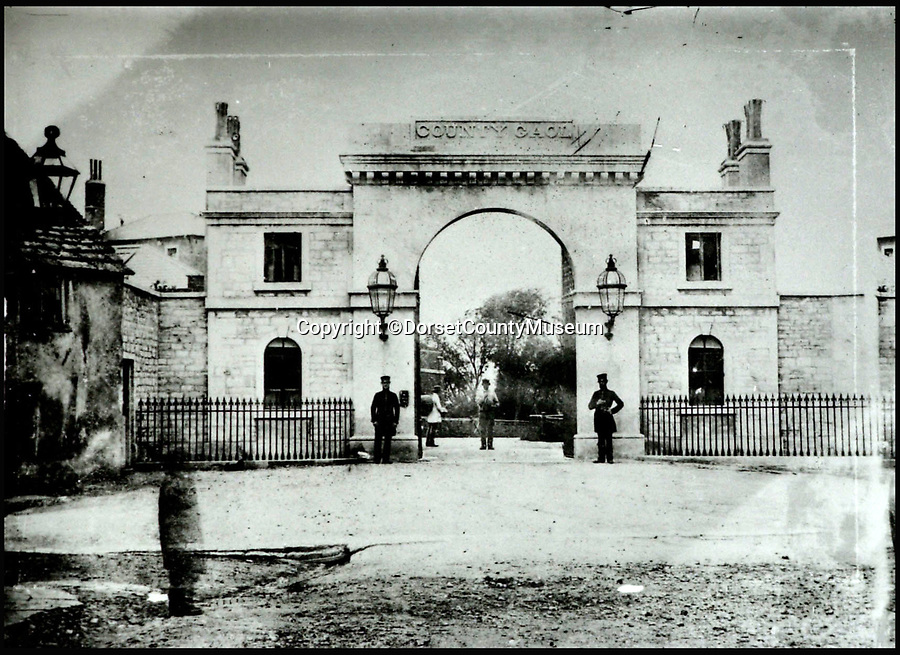 BNPS.co.uk (01202 558833)<br /> Pic: DorsetCountyMuseum/BNPS<br /> <br /> The gates of Dorchester prison in 1856, where a 16 year old Thomas Hardy watched Martha Brown hung.<br /> <br /> <br /> The remains of the real-life Tess of the D'Urbervilles are to be exhumed from a former prison ground and given a proper burial 162 years after her execution, church authorities have ruled.<br /> <br /> Martha Brown, a convicted murderess who inspired author Thomas Hardy after he witnessed her execution in 1856, is one of the 47 convicts buried at Dorchester Prison in Dorset.<br /> <br /> The closed jail has been sold off for development with 185 houses due to be built there. <br /> <br /> The developers, City and Country, wanted to leave the remains alone or to only remove those disturbed in the building work but campaigners, including Downton Abbey creator Julian Fellowes, have been fighting for all the bodies to be exhumed.<br /> <br /> And after it was discovered the burial ground was consecrated, it was left to the Bishop of Salisbury to make the decision.
